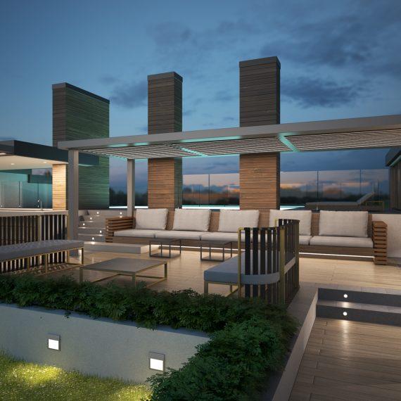 Angolo relax di un rooftop garden con piscina dopo il tramonto