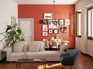 Piccolo salotto/pranzo contemporaneo con parete rosso fuoco